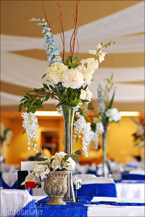 wedding flowers decor royal blue cream gym reception